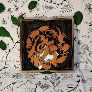 Trivet with carved Australian animals