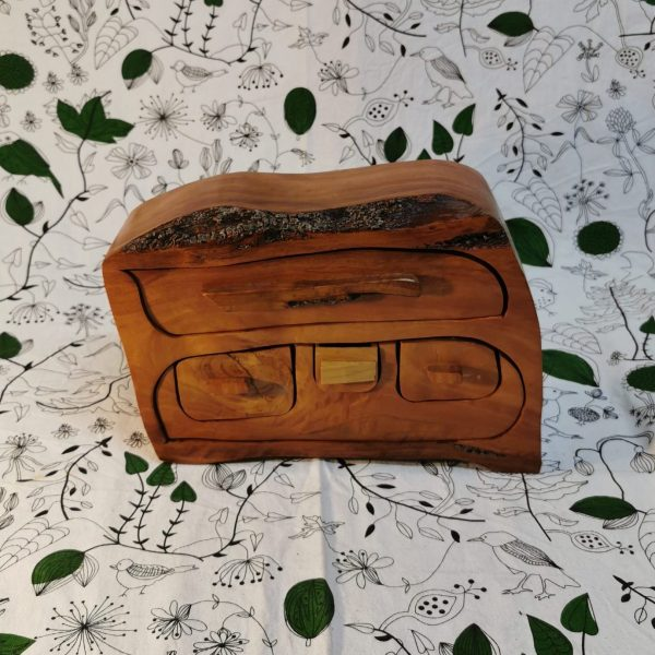 Wooden jewellery box with multiple drawers
