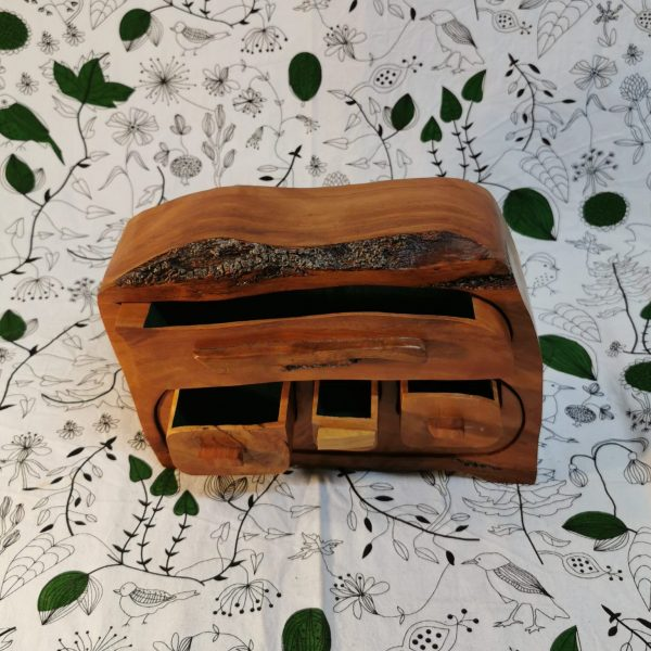 Wooden jewellery box with multiple drawers top view