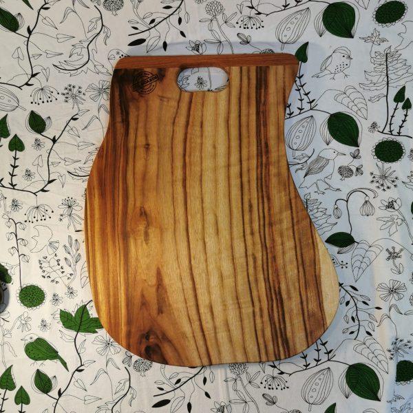 Tilted circular wooden cutting board